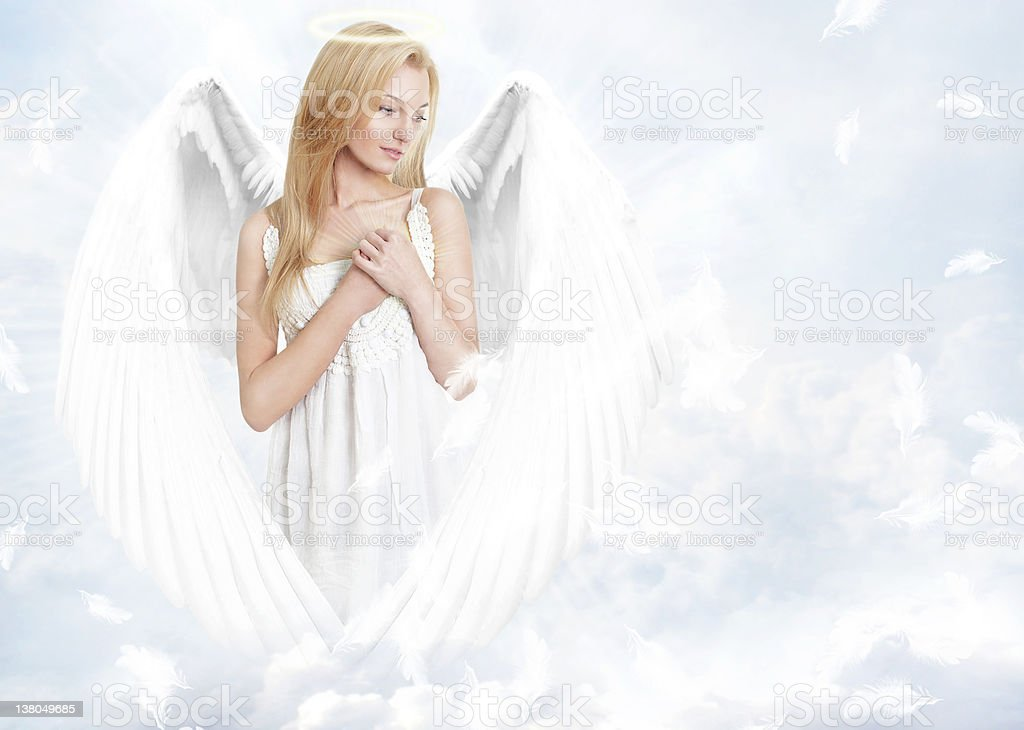 Young woman as angel with white wings and aureole stock photo