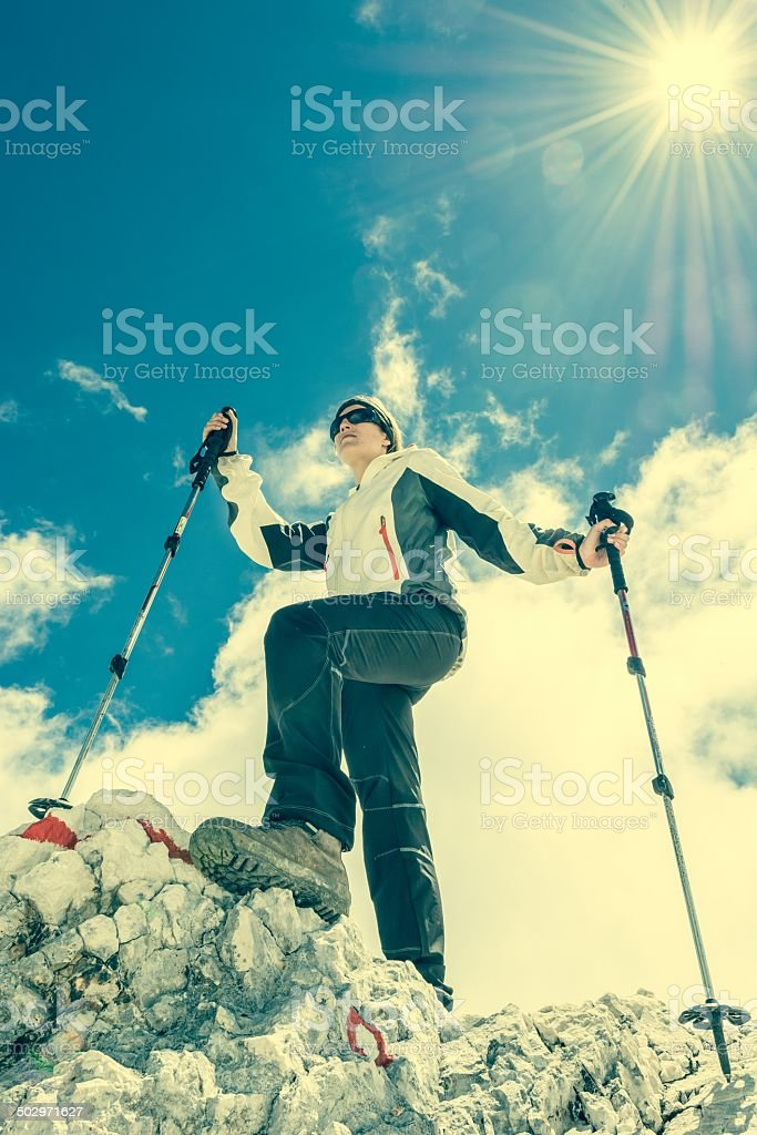 Young woman ascending a mountain royalty-free stock photo