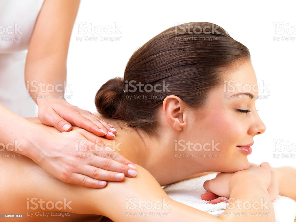 Close-up of young woman receiving back massage at day spa royalty-free stock photo