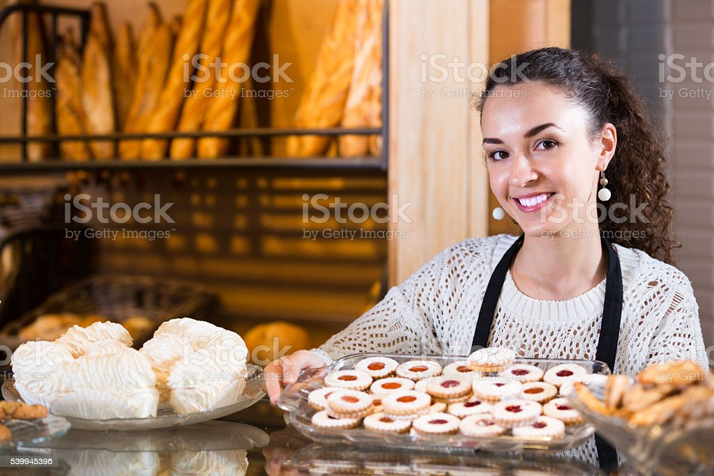 young woman at bakery display stock photo