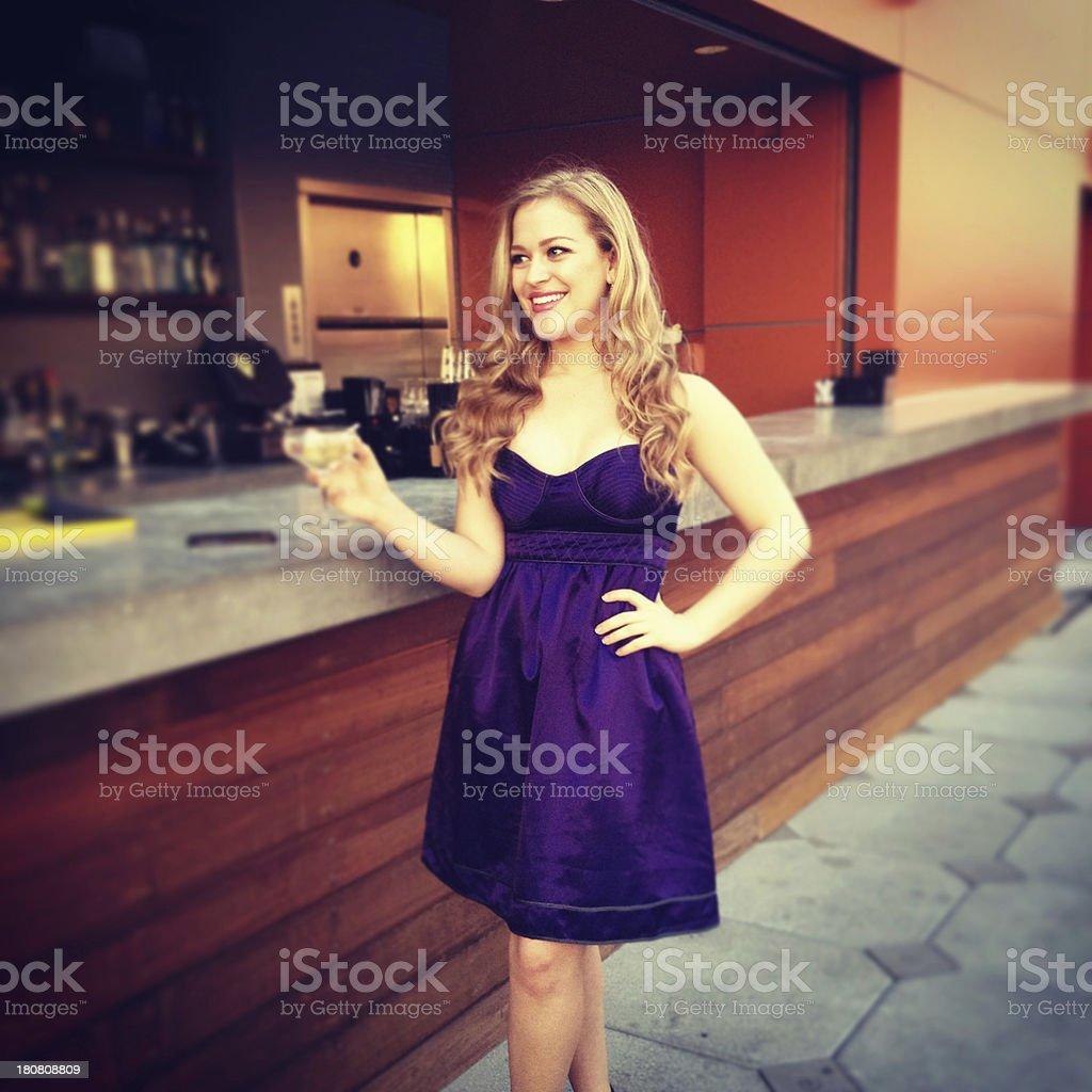 Young woman at bar stock photo