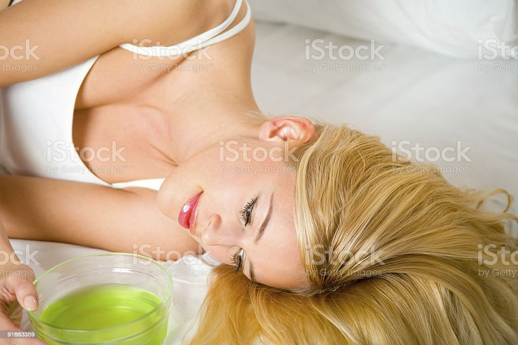 Young woman at bedroom with hair masque royalty-free stock photo