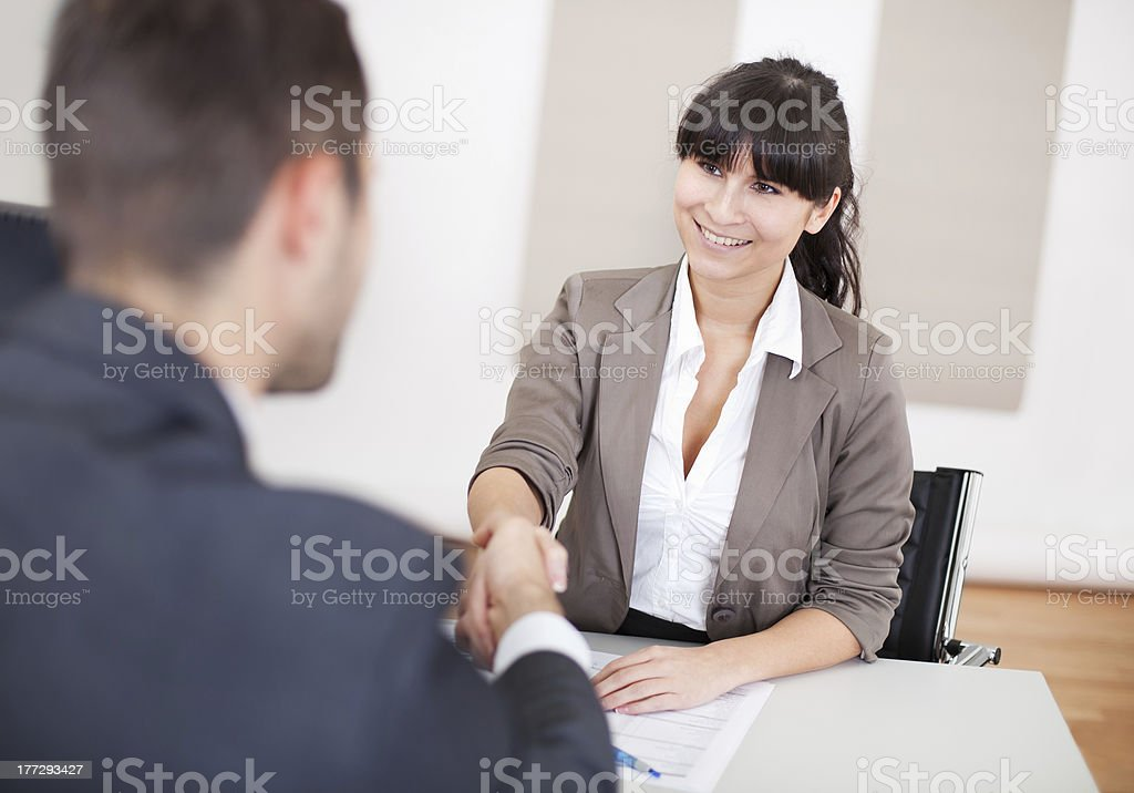 Young woman at business interview shaking hands royalty-free stock photo