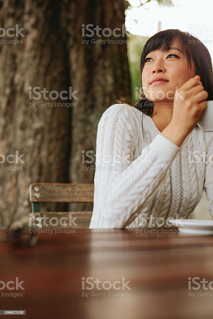 Young woman at cafe with a cup of coffee stock photo
