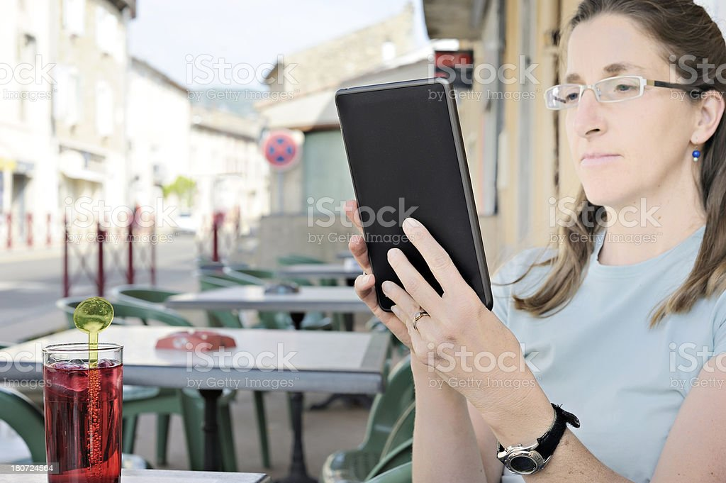 Young woman at cafe with e-reader royalty-free stock photo