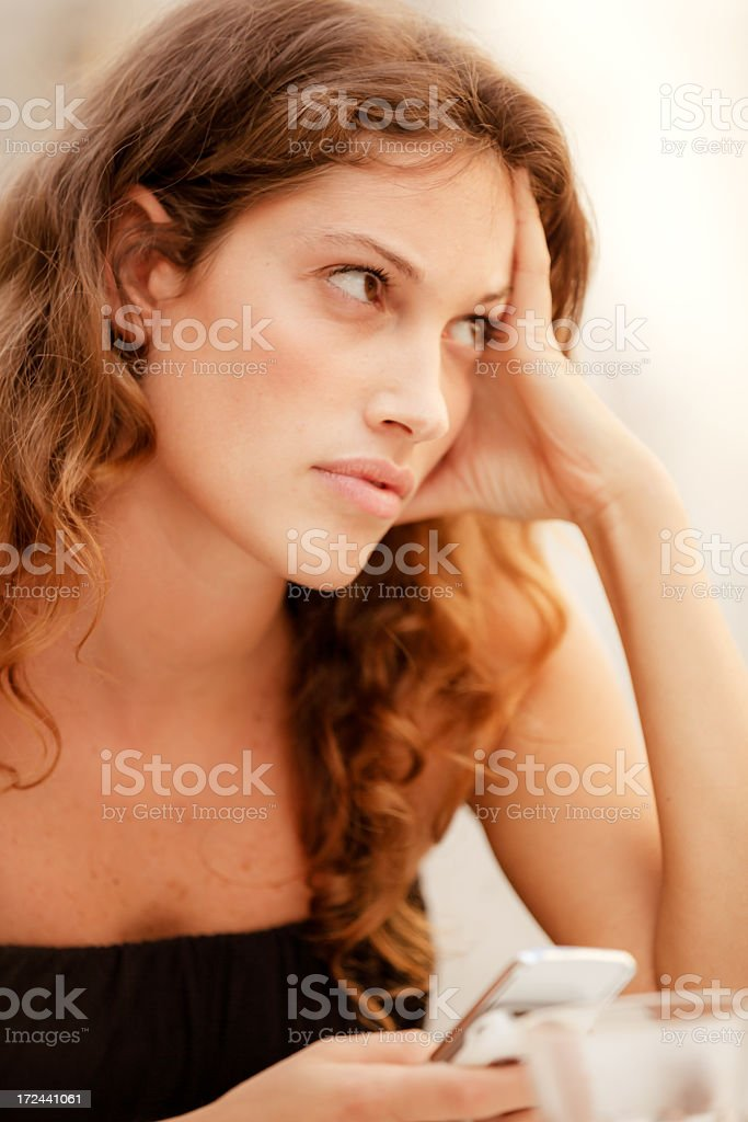 young woman at cafe with mobile phone royalty-free stock photo