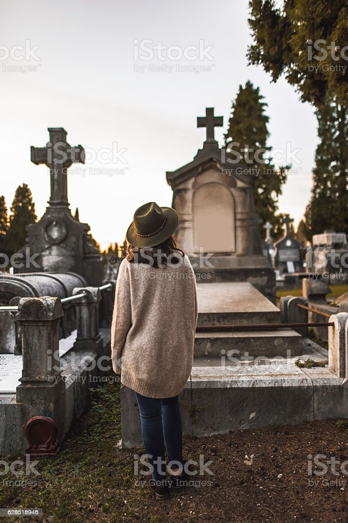 Young woman at cemetery stock photo