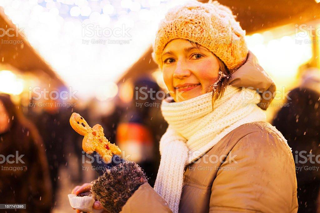 young woman at christmas market royalty-free stock photo