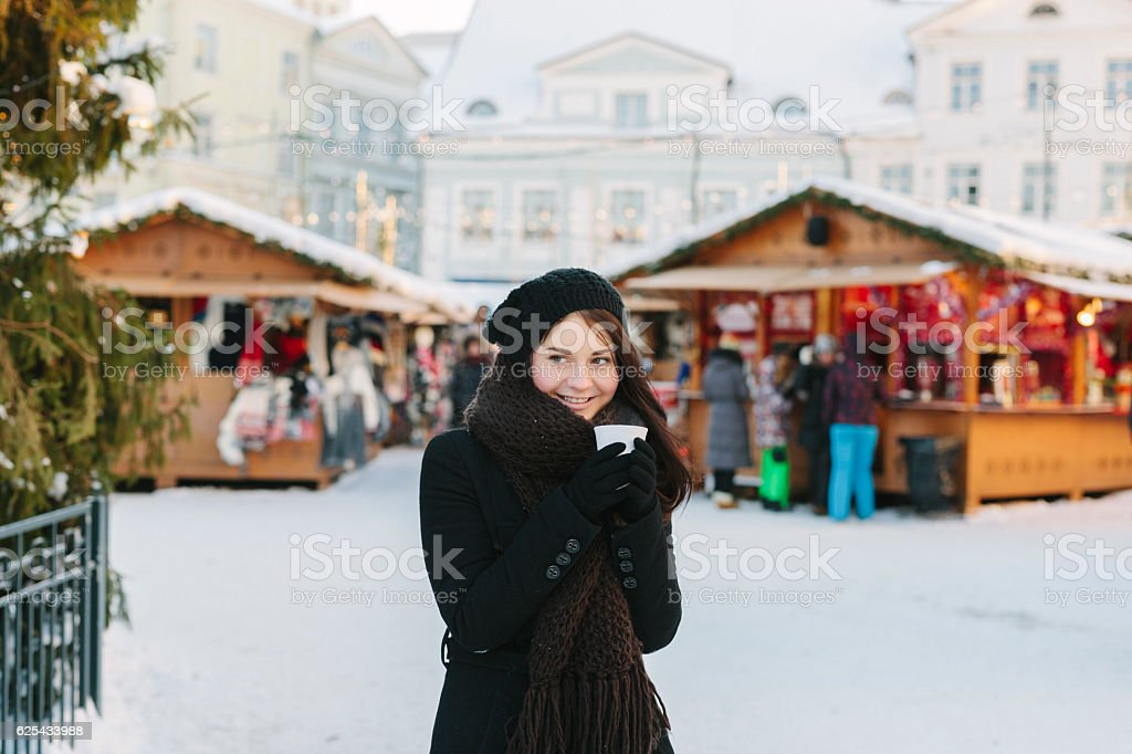 Young Woman at Christmas Market stock photo