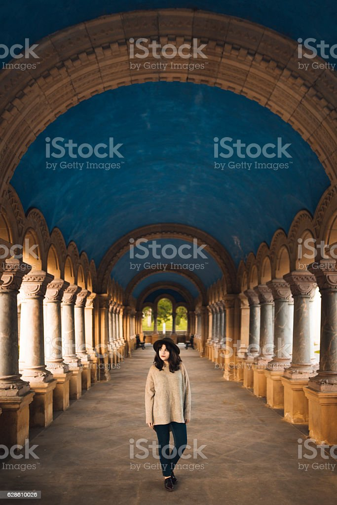 Young woman at cloister stock photo