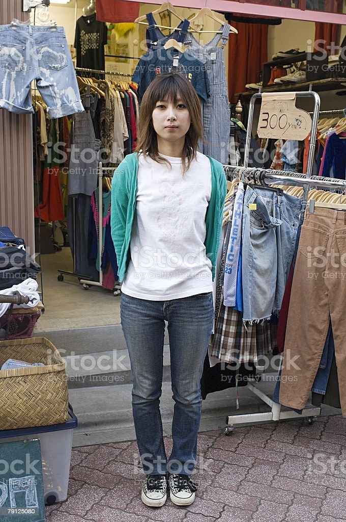 Young woman at clothing stall royalty-free stock photo