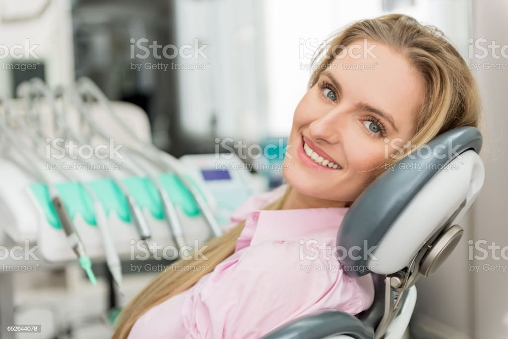 Young woman at dental test stock photo