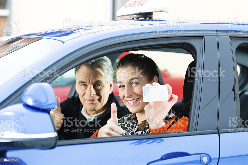 Young woman at driving lesson royalty-free stock photo