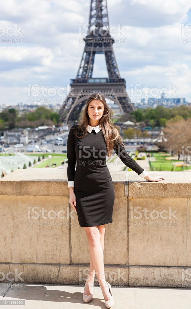 Young Woman At Eiffel Tower in Summertime stock photo