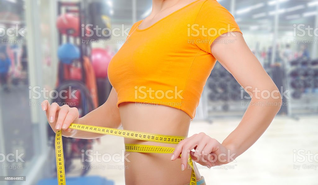 Young woman at fitness club stock photo