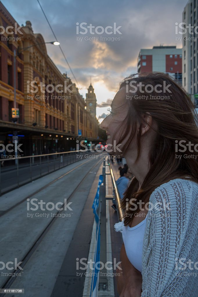 Young woman at Flinders Street railway station waiting for tramway stock photo