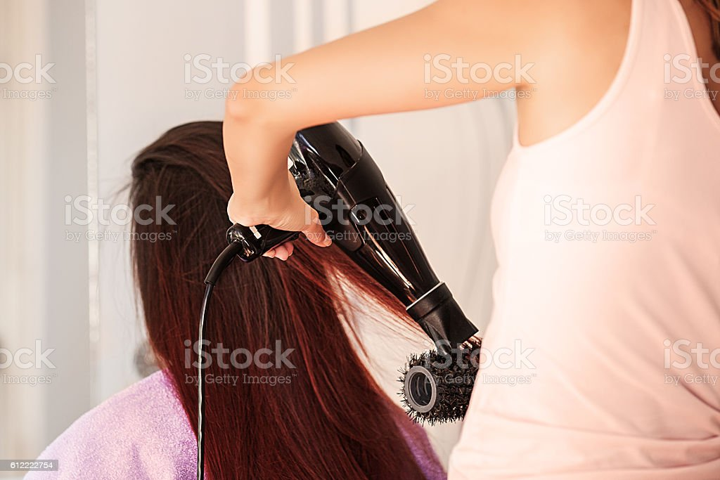 Young Woman at Hairdresser stock photo