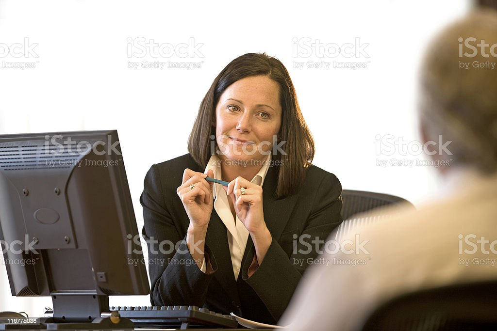 Young Woman At Her Desk royalty-free stock photo