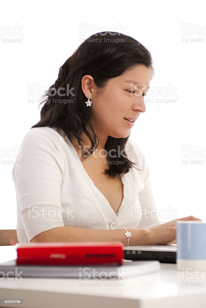 Young woman at her desk stock photo
