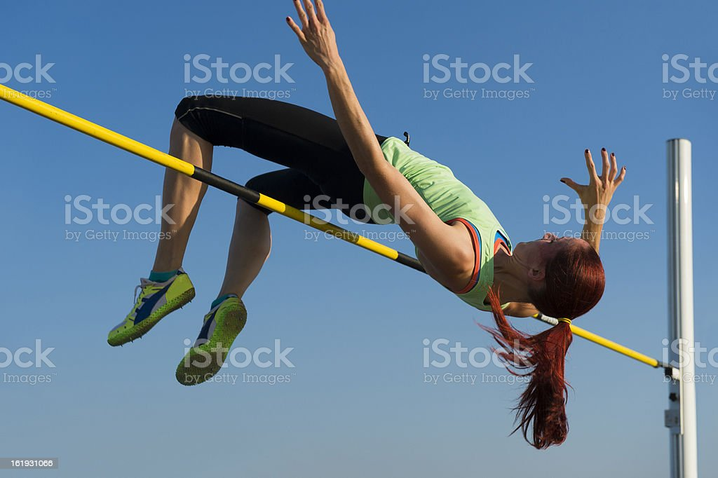 Young woman at high jump stock photo