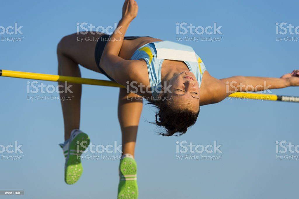 Young woman at high jump stock photo