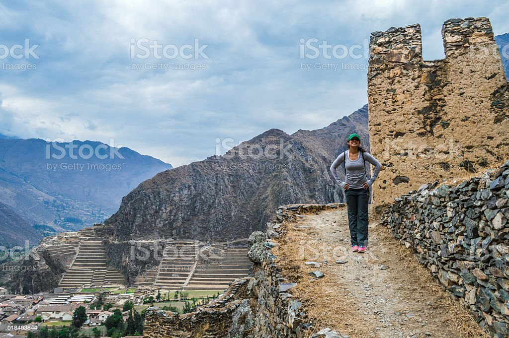 Young woman at Inca Ruins in Peru - Ollantaytambo Fortress stock photo
