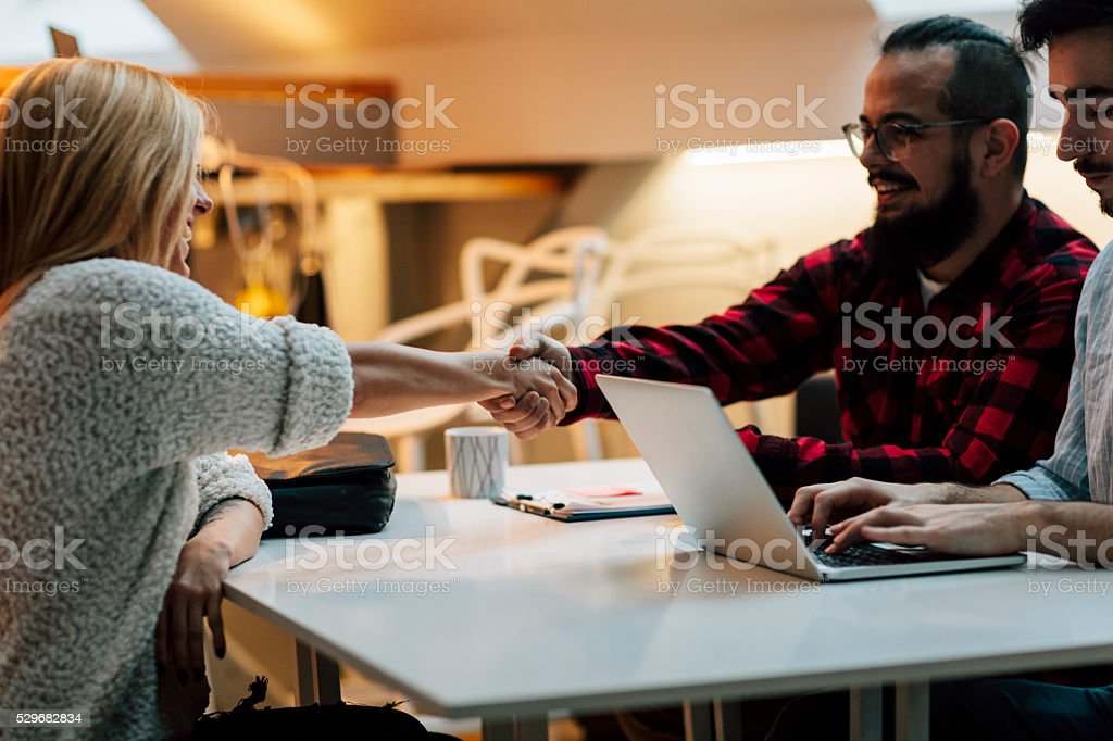 Young woman at job interview in an startup company. stock photo