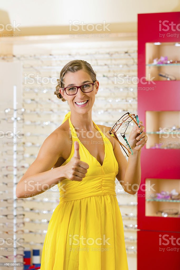 Young woman at optician with glasses stock photo
