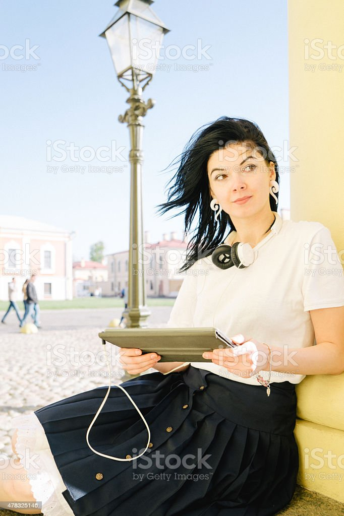 Young Woman At Peter and Paul Fortress Using Digital Tablet stock photo