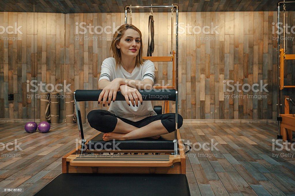 Young woman at pilates studio stock photo