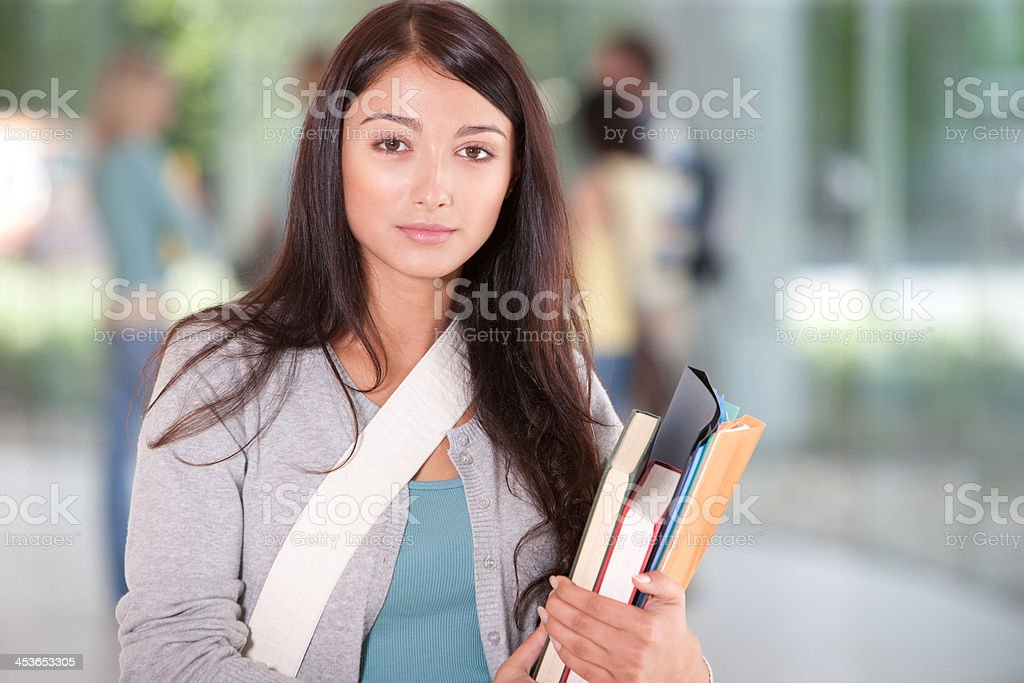 Young Woman at school with school books stock photo