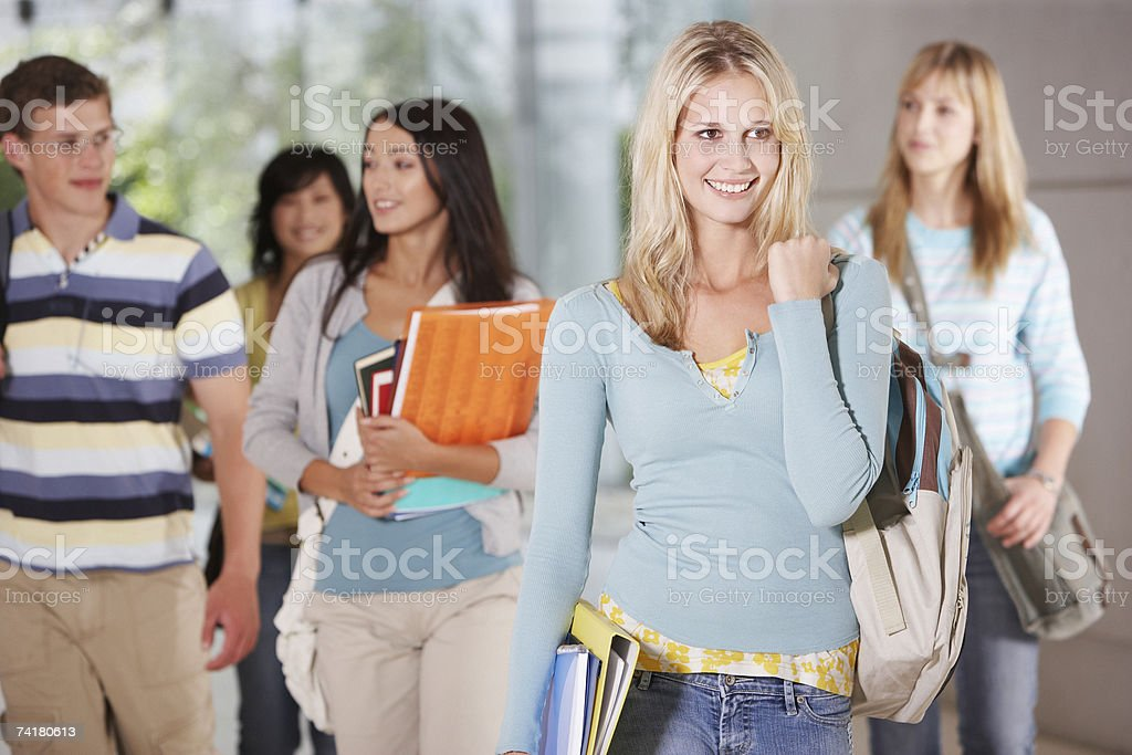 Young woman at school with school books royalty-free stock photo