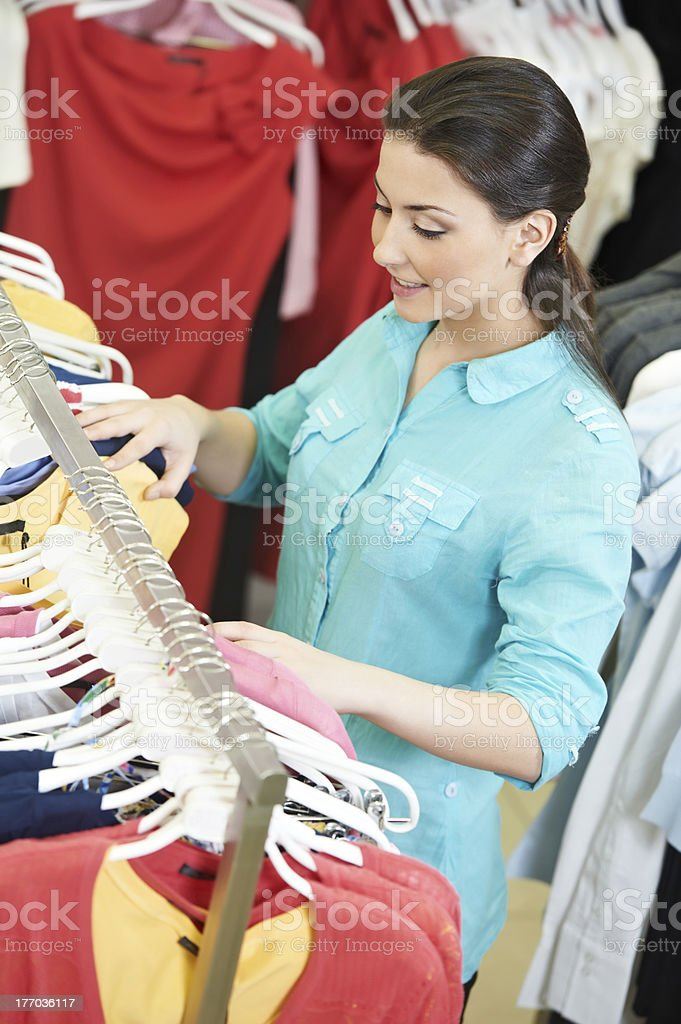 Young woman at shirts clothes shopping royalty-free stock photo
