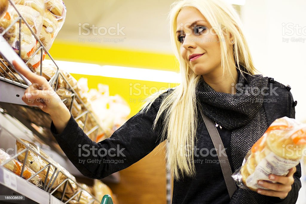 Young woman at supermarket royalty-free stock photo