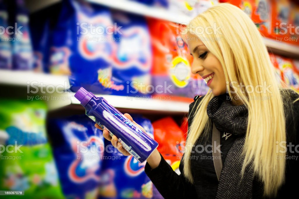 Young woman at supermarket stock photo
