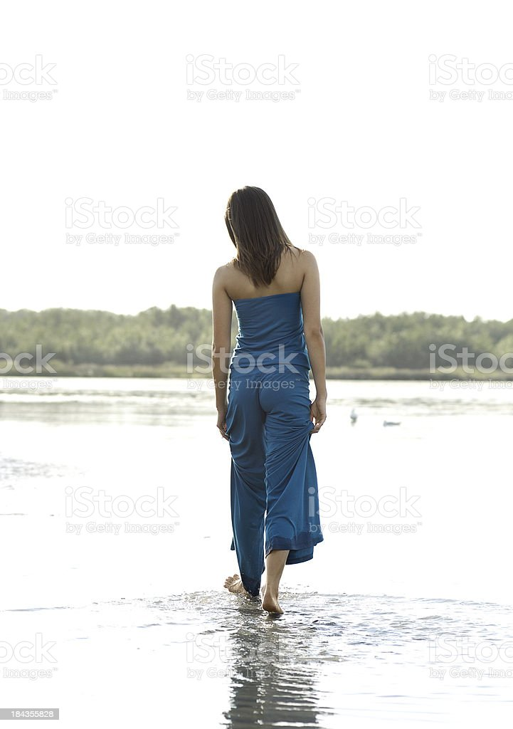 Young woman at the beach royalty-free stock photo