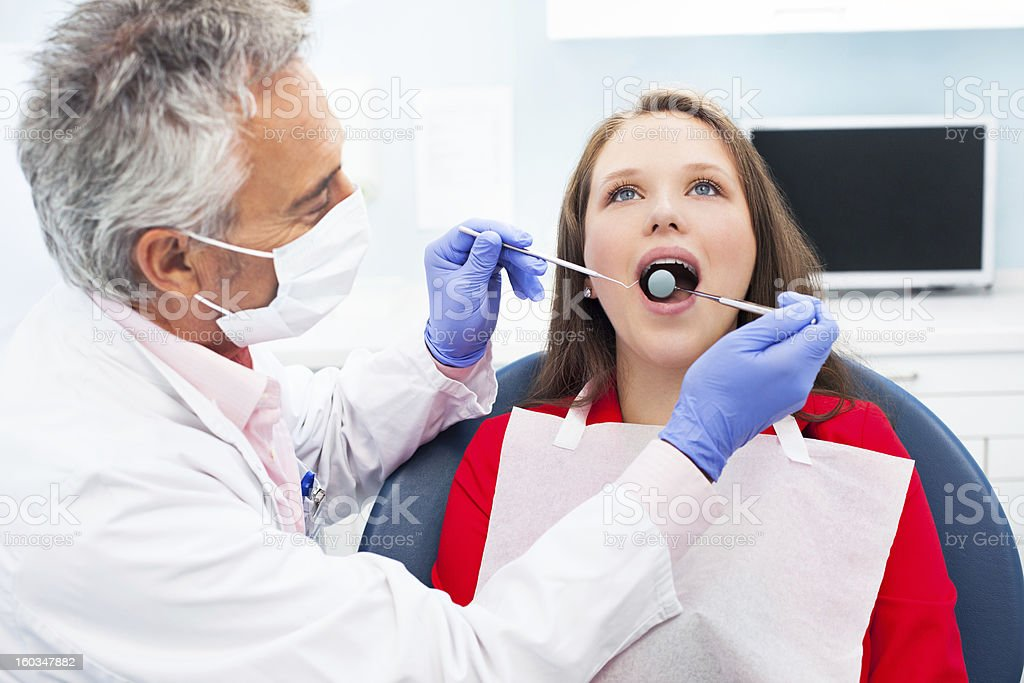 Young woman at the dentist royalty-free stock photo