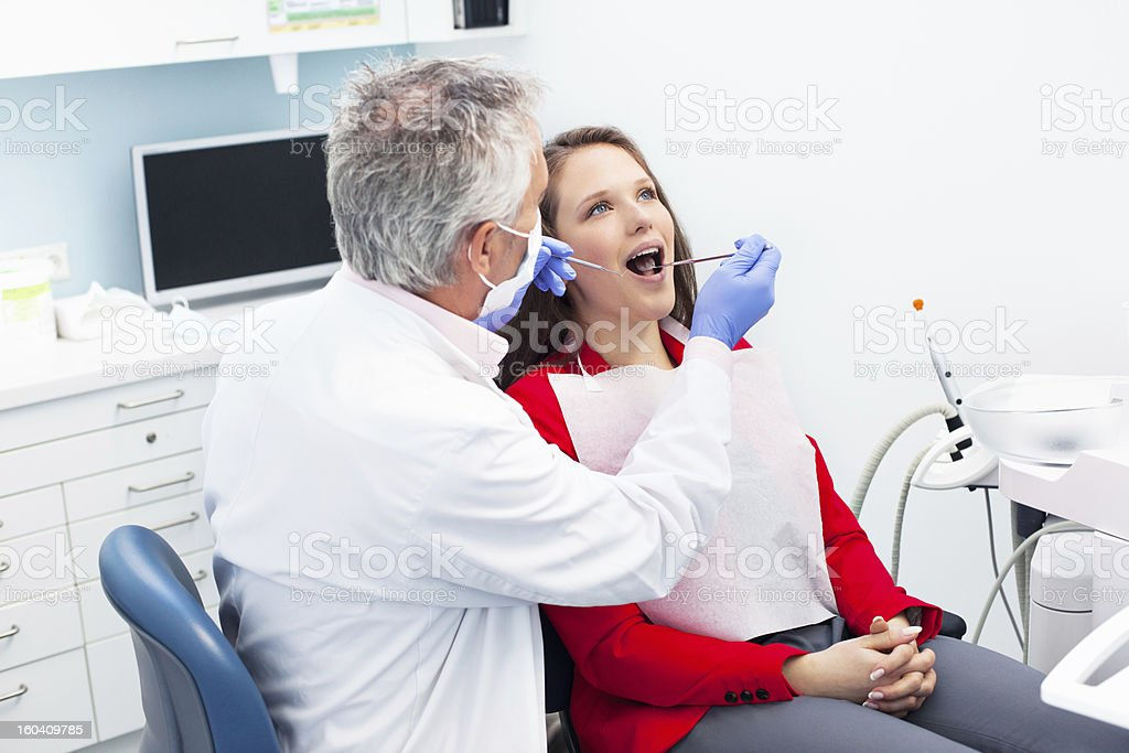 Young woman at the dentist stock photo