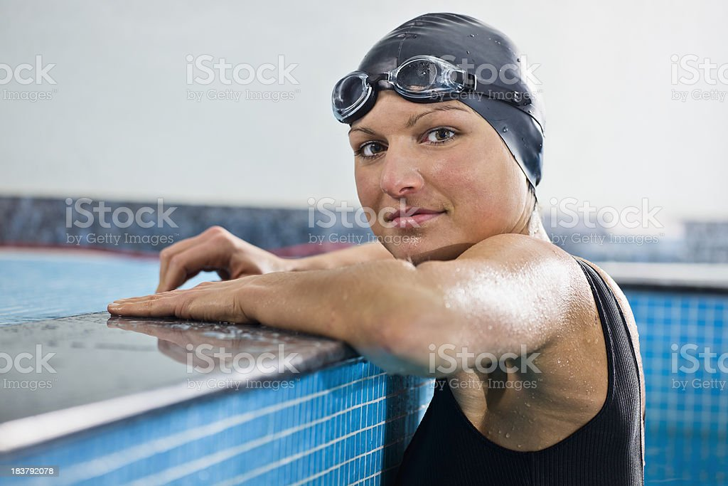 Young Woman at the Edge of a Swimming Pool royalty-free stock photo
