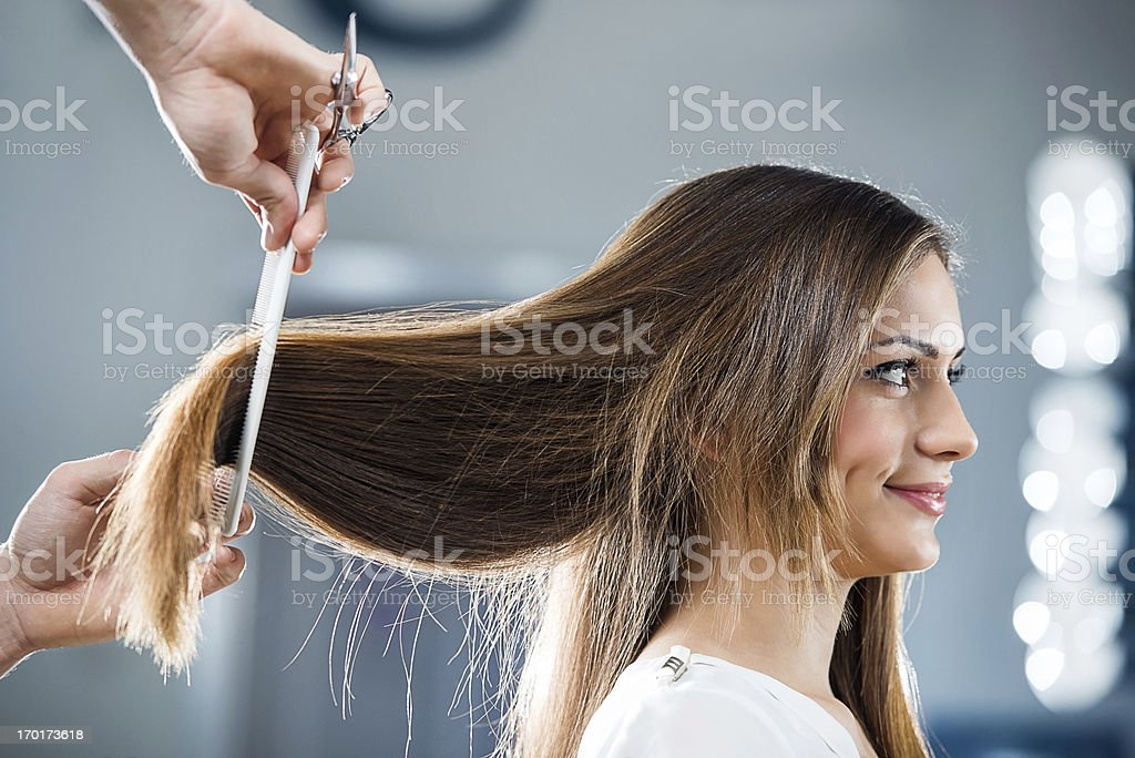 Young woman at the hairdresser's. stock photo