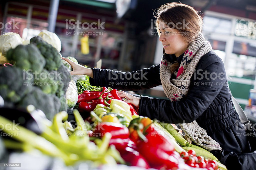 Young woman at the market stock photo