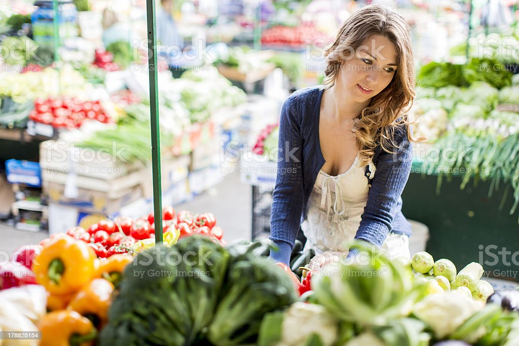 Young woman at the market royalty-free stock photo