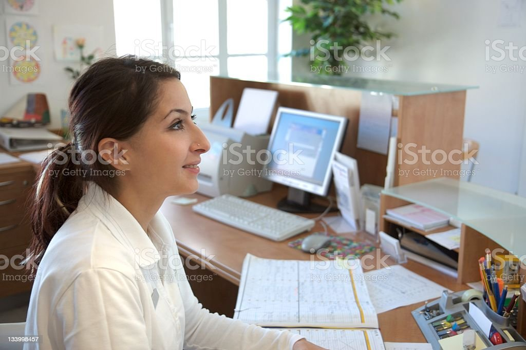 young woman at the reception desk stock photo