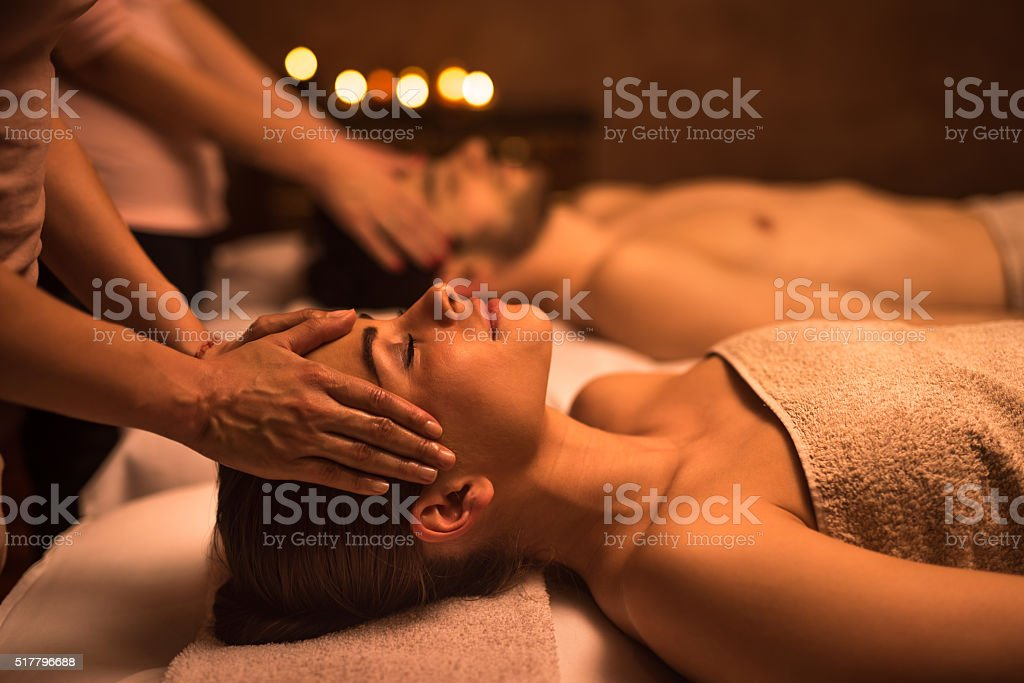 Young woman at the spa enjoying in head massage. stock photo
