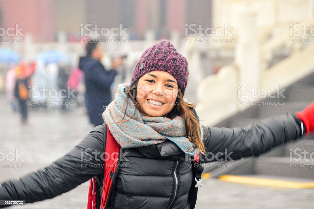 Young woman at the Temple of Heaven in Beijing, China stock photo
