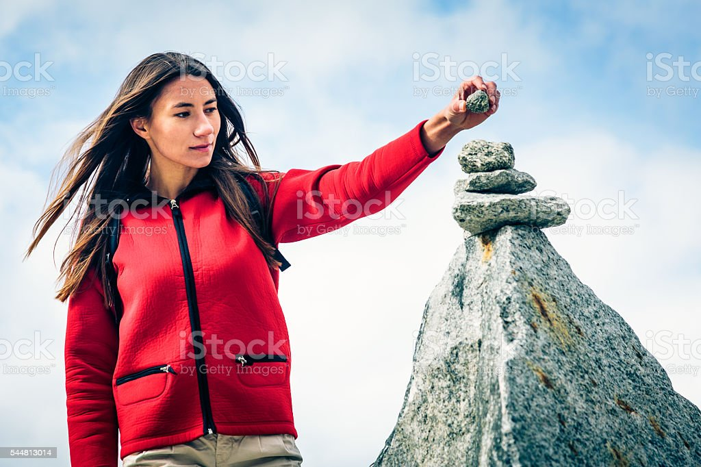 Young Woman at the Top of the Mountain stock photo