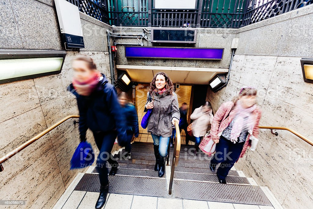 Young woman at tube exit in London stock photo