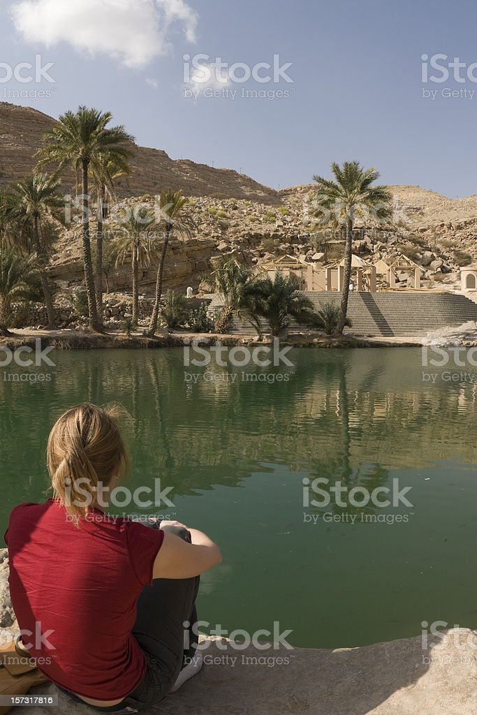 Young woman at Wadi Bani Khalid royalty-free stock photo