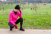 Young woman athlete feeling lightheaded or with headache