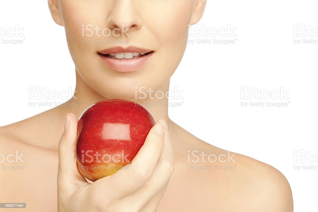 Young Woman Attract By A Red Apple stock photo